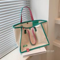 韩国ins帆布包母婴手提外出妈咪包上班族便当包文艺轻便妈妈包