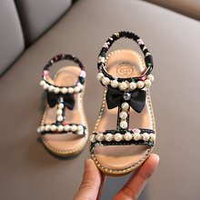 女童凉鞋2021新款夏季时zg10蝴蝶结rw露趾儿童珍珠沙滩鞋子