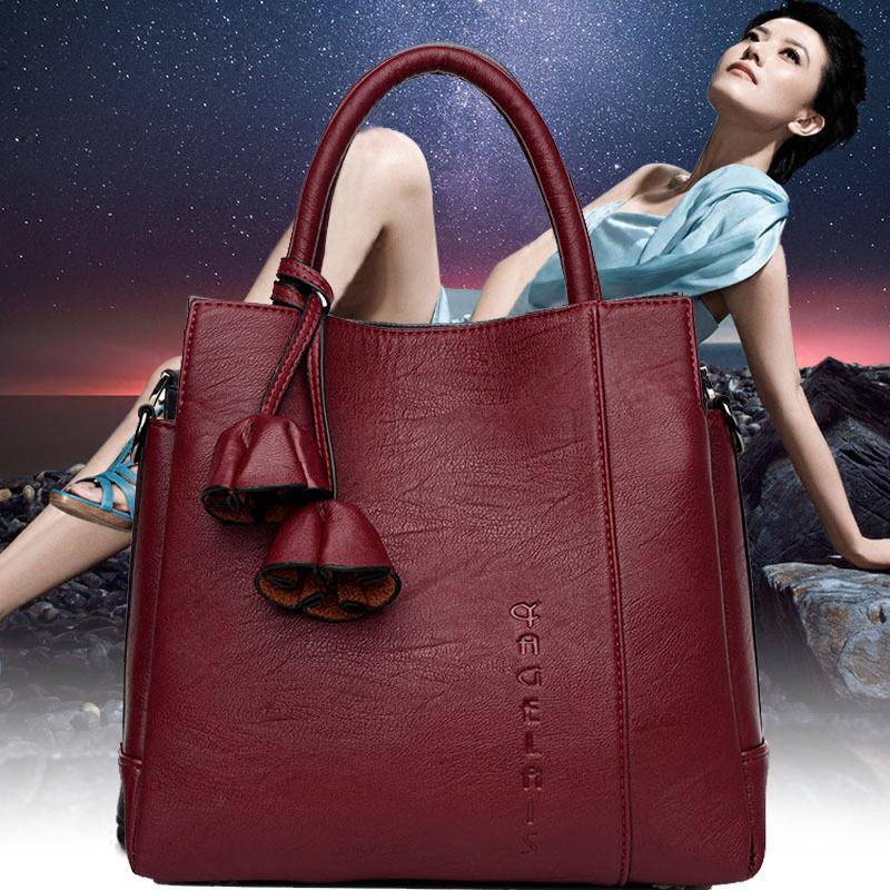 雅格莱诗水桶包2017新款韩版女包手提单肩斜跨大包中老年妈妈包包