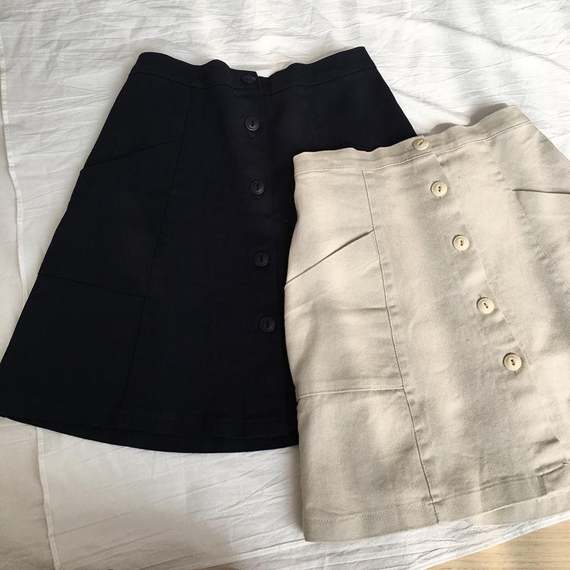 missqiuqiu 夏日@百搭少女/减龄单排扣洗水面料半身裙短裙.