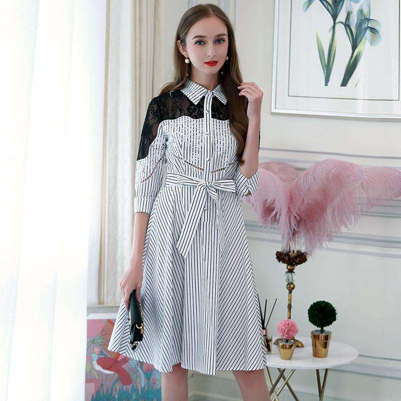 春装2018新款女重工拼接蕾丝刺绣系带收腰伞摆条纹衬衫ins连衣裙