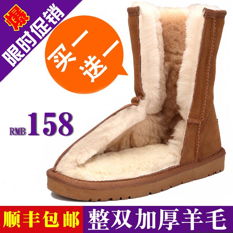 冬季羊皮毛一体雪地靴女中筒带扣女靴防水真皮圆头平底女鞋保暖