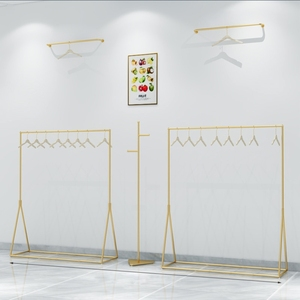 Store floor clothes rack clothing store shoes bags clothing display rack on the wall men's shop display rack women's shop