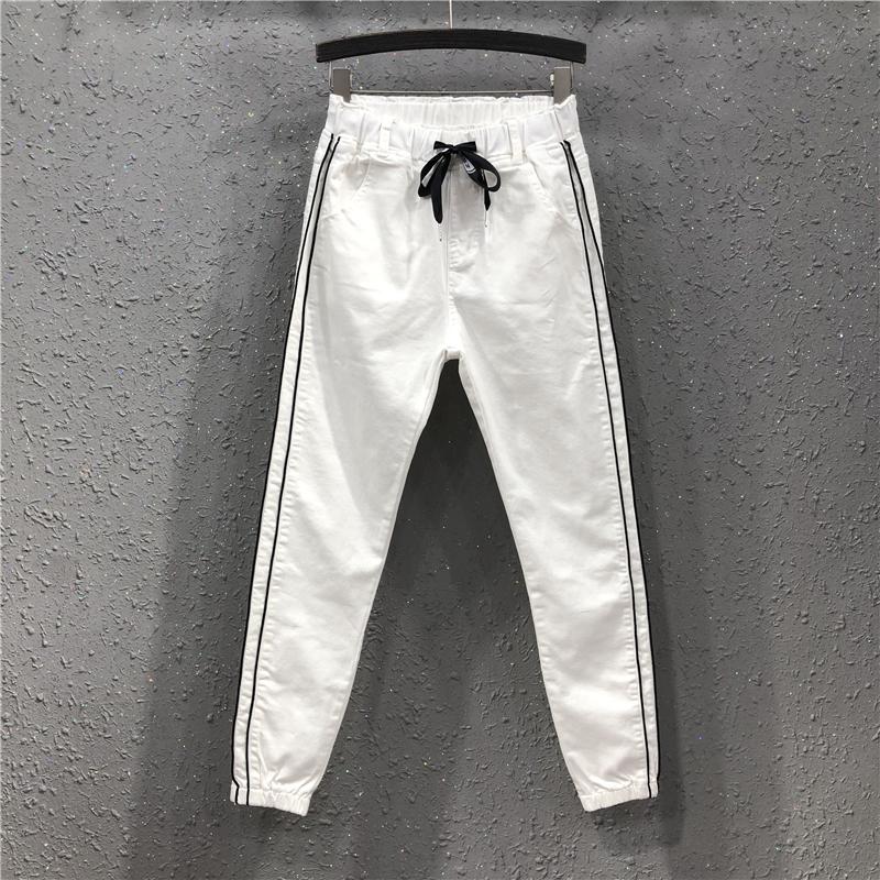 白色休闲牛仔束脚裤女春夏新款欧洲站个性侧条纹松紧腰宽松哈伦裤
