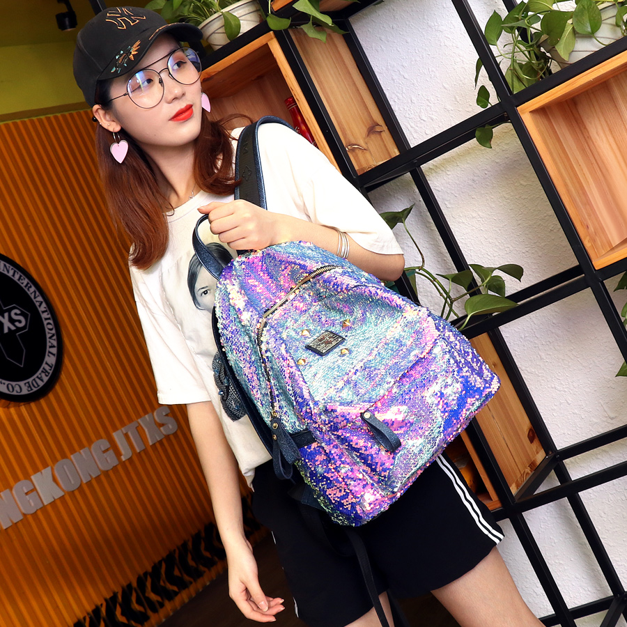 点击查看商品:JTXS2019新款超火双肩包女时尚亮片百搭铆钉旅行背包韩版学生书包