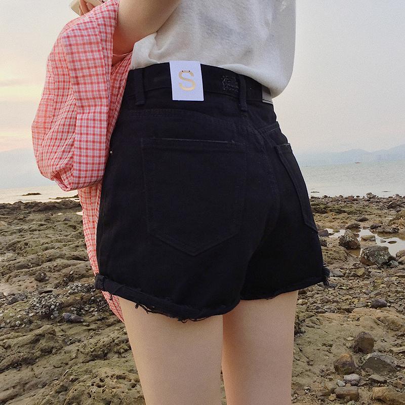 时髦破洞毛边黑色牛仔短裤女夏季热裤2018新款宽松百搭高腰阔腿裤