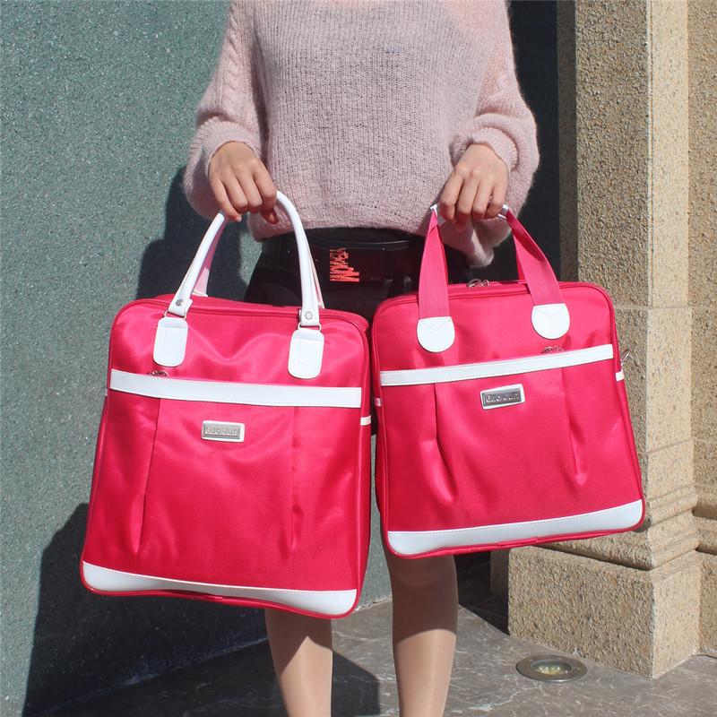 韩版短途旅行袋防水小容量旅游包手提包健身包女潮背面可套拉杆箱