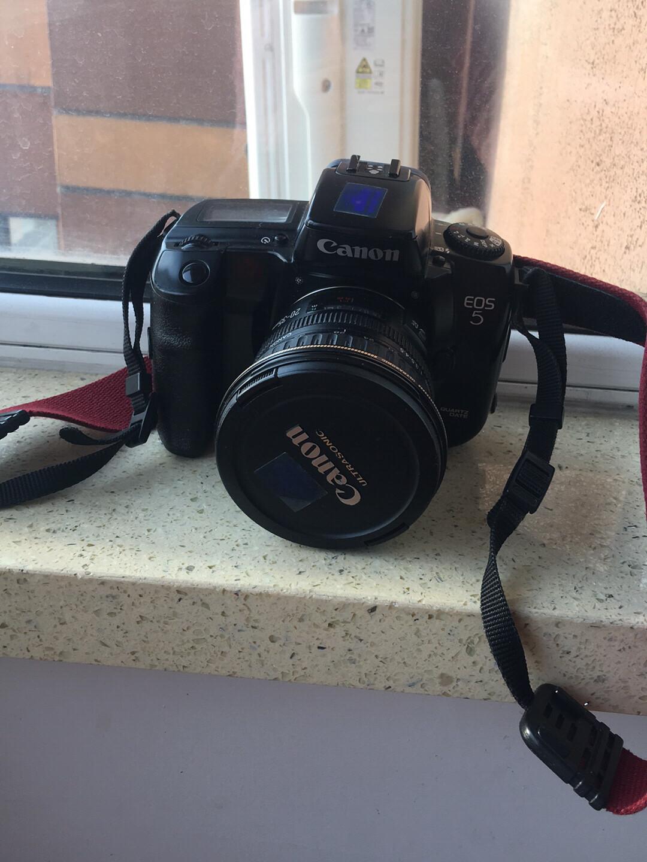 佳能相机,老式胶卷相机,并且还带一个长焦镜头,不包邮,自取