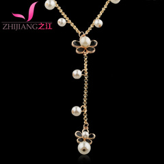 Zhijiang female four-leaf clover necklace sweater chain long accessories autumn Korea wild Pearl pendant Korean jewelry