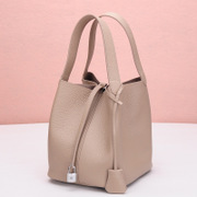 Ou Xuan female leather header layer of leather bucket bag basket bag Togo leather lychee lines with bag