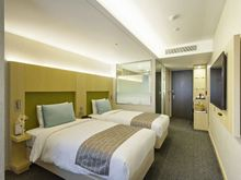 Primo Hotel twin bed room (Providing T-shirts)