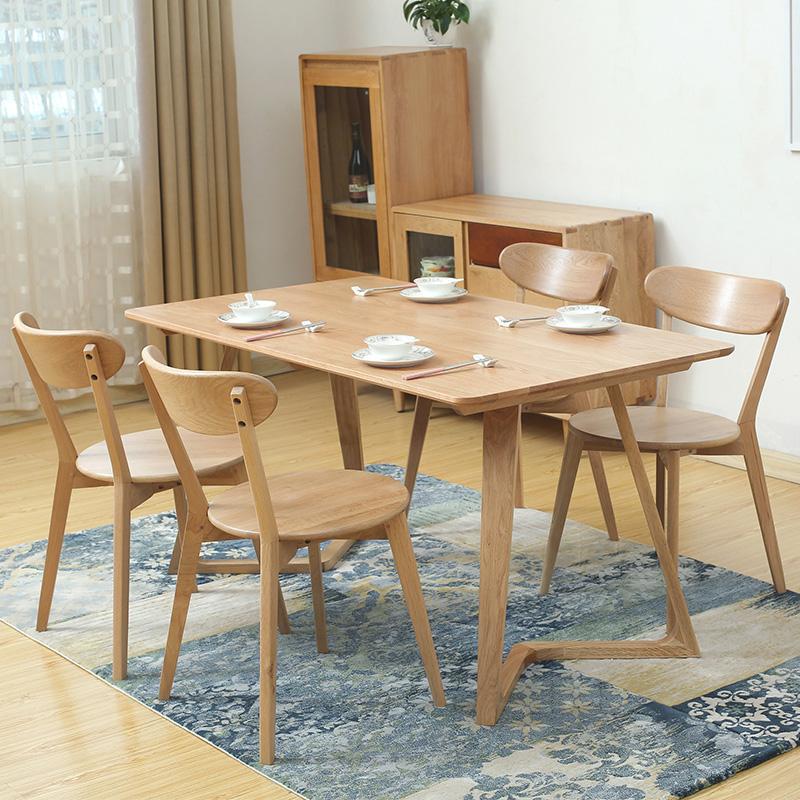 北欧风小户型实木餐桌椅子家用橡木长方形多功能简约现代原木桌子