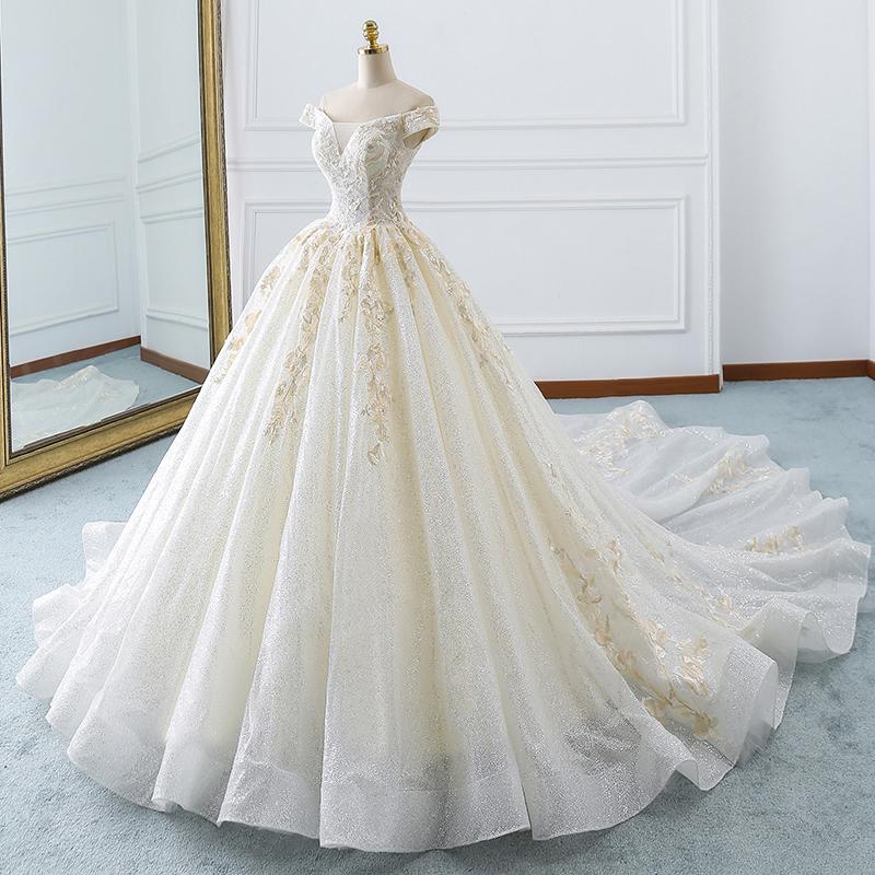 轻森系婚纱2018新款一字肩领公主蓬蓬裙大拖尾梦幻显瘦纱香槟色奢