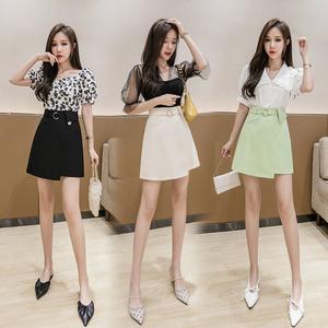 夏季短裙高腰时尚设计感不规则半身裙女显瘦小雏菊花扣a字包臀裙
