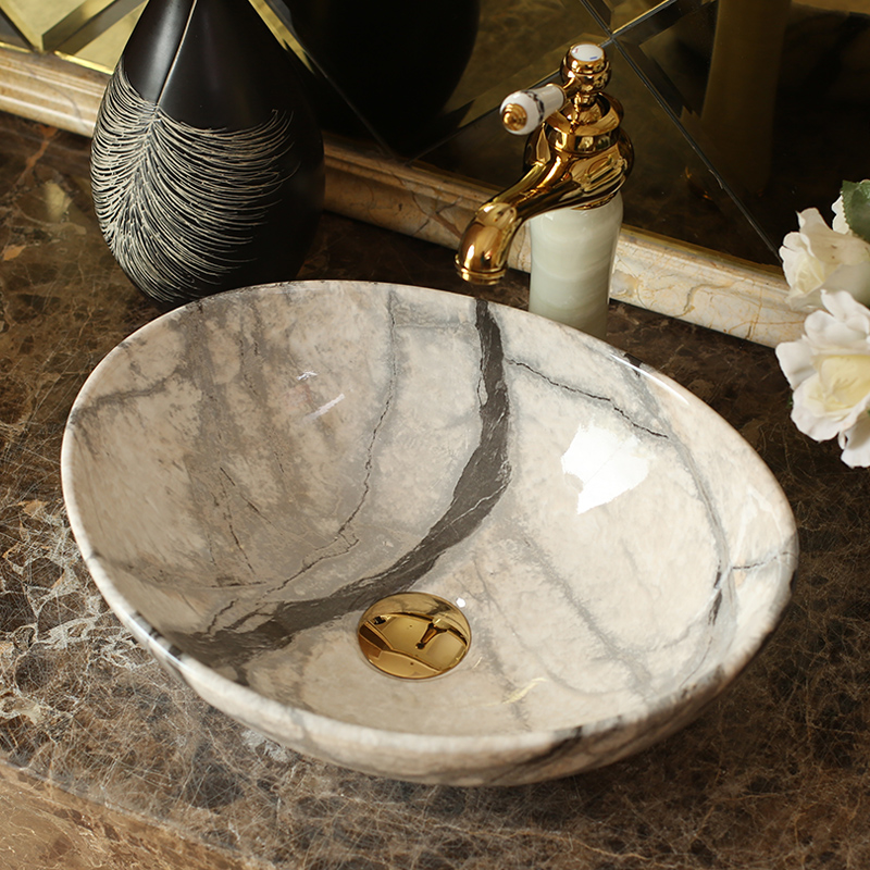 Jingdezhen ceramic stage basin elliptic continental basin of I and contracted marble art bathroom sinks