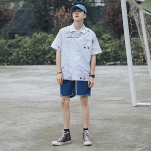 2019夏季bt365注册_bt365.com_bt365网站打开不了卡通涂鸦印花薄款短袖衬衫男士潮流宽松中袖白色衬衣