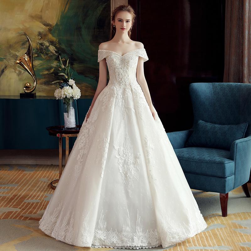 婚纱礼服新娘结婚2018新款一字肩拖尾女公主齐地森系主简约轻赫本