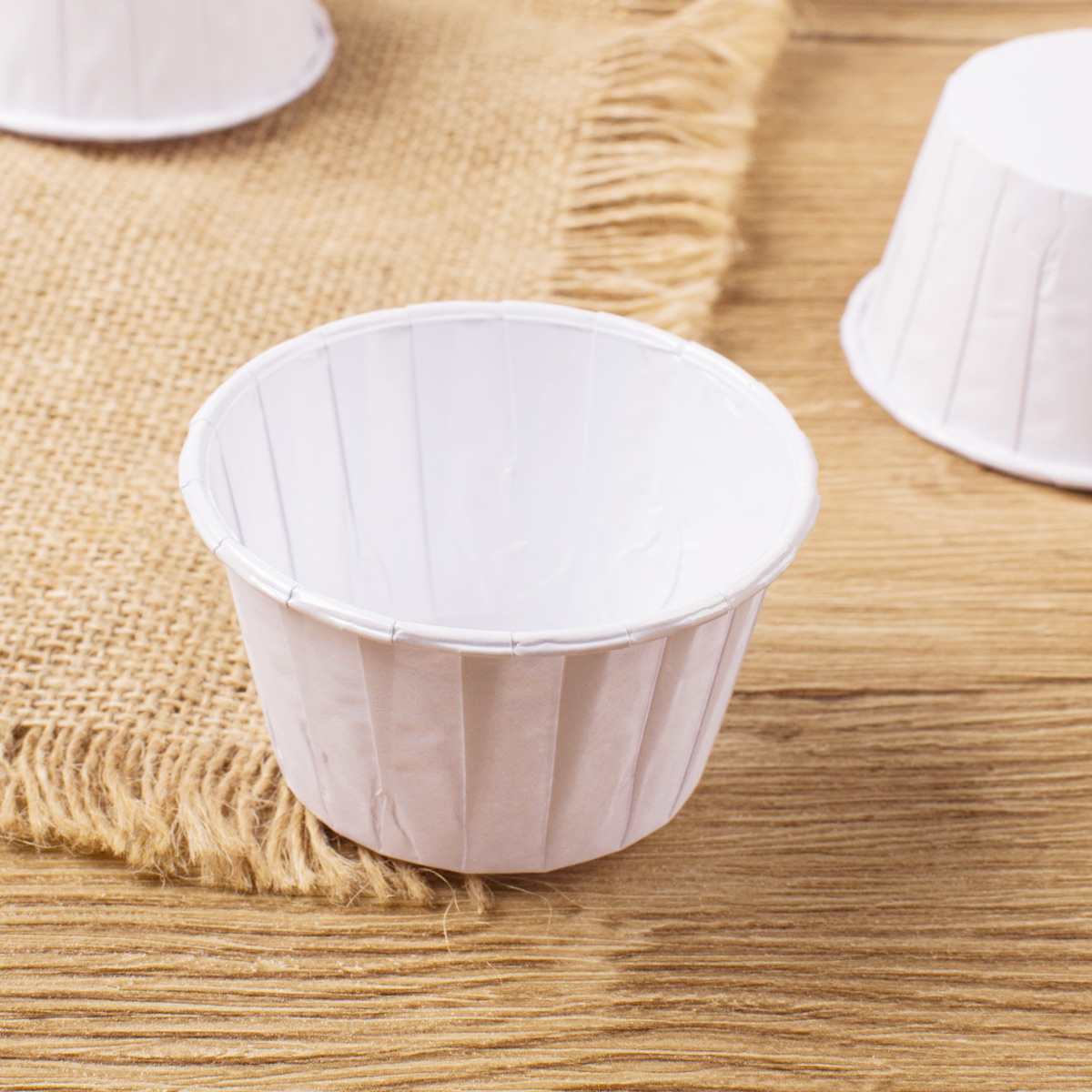 small paper cups Those little paper cups can also be used to bake all sorts of tasty treats how to bake in dixie cups how to prebake mini tartlet shells.
