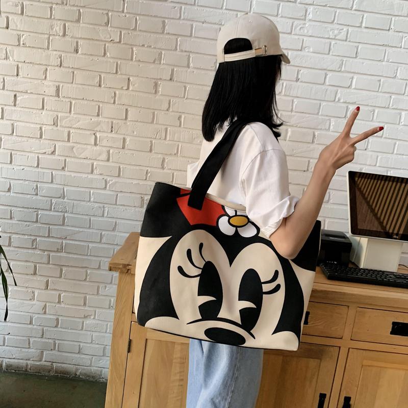 大容量包包女2021流行简约帆布包单肩手提包学生旅行印花托特大包