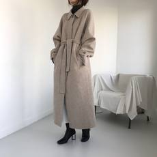 Korea autumn and winter niche temperament oat color lapel buckle long section tied bandwidth loose long coat wool coat