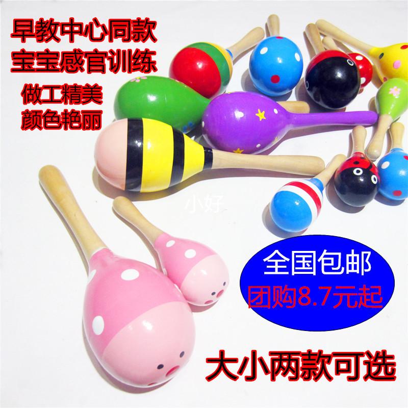 新生婴儿宝宝沙锤 儿童打击乐器0-1岁听视训练手握摇铃 木质玩具