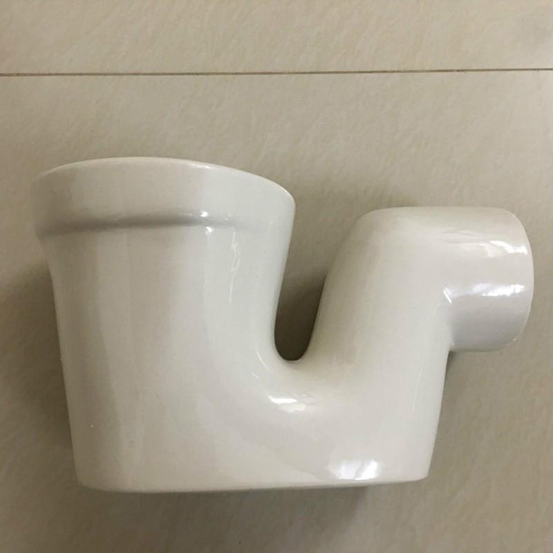 卫浴分体蹲便器防臭器配件下水管卫生间隔断配件陶瓷存水弯头