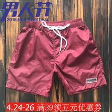 Beach pants men beach holiday loose solid color pants fitness sports shorts with lining