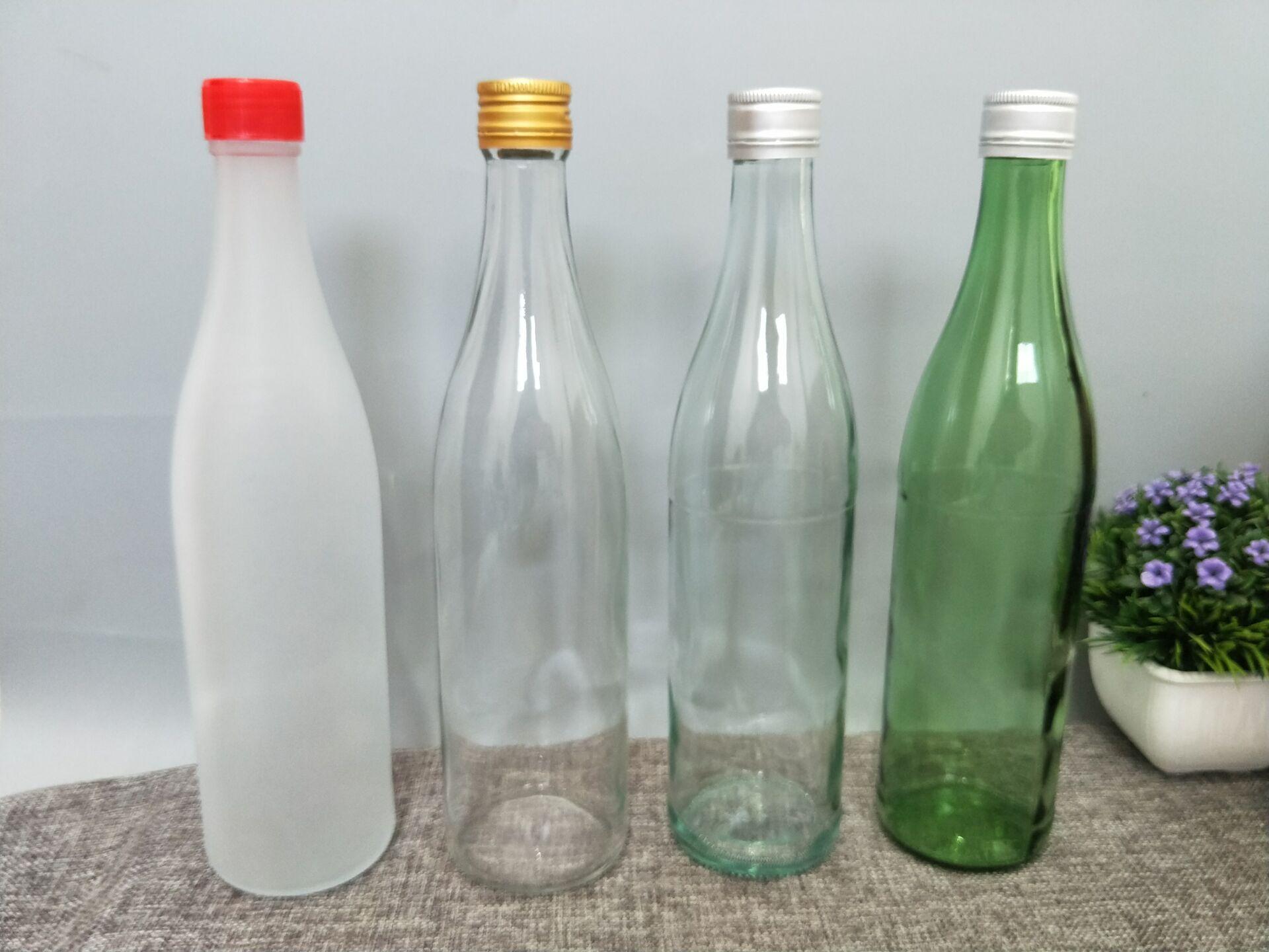 一斤透明酒瓶玻璃瓶500ml二锅头白酒牛栏山v酒瓶瓶设备空瓶鸡舍瓶圆形白酒保温图片