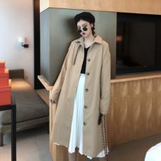 Autumn women 2018 new suit fashion two-piece long section Hong Kong style retro coat windbreaker + pleated skirt tide