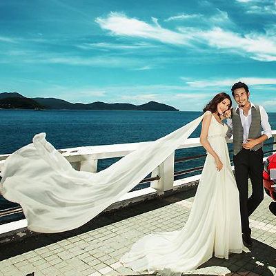 旅拍海景主题婚纱影楼拍照情侣装主持人服装性感礼服小清新白色