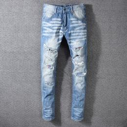 欧美高街潮牌AMIRI新款修身牛仔裤 男士浅色刮烂破洞补丁乞丐裤男