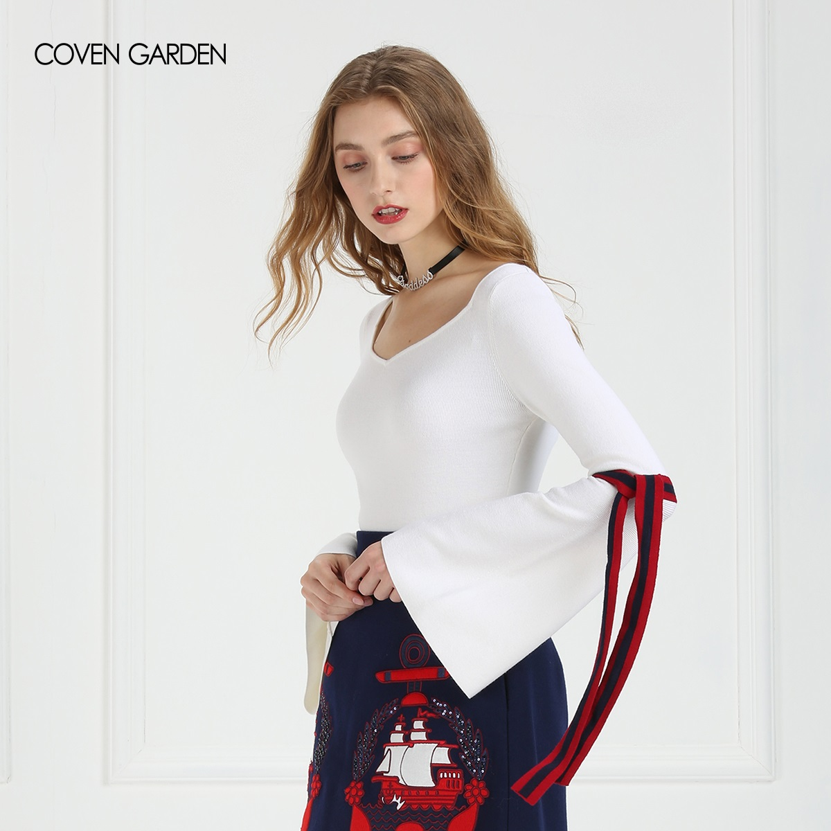 COVEN GARDEN/哥文花园春装纯色圆领羊毛喇叭袖针织衫上衣毛衣女