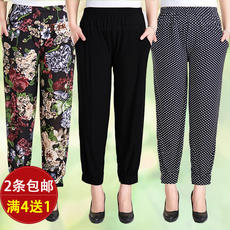 Middle-aged and old women's trousers thin summer leisure ice silk pants plus fertilizer to increase the code flower pants mother loaded nine pants