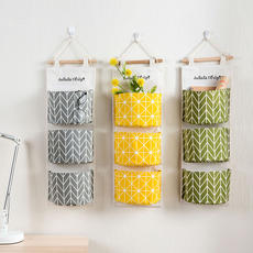 Home cotton and linen waterproof storage bag hanging multi-layer sling fabric door behind the debris storage bag storage bag