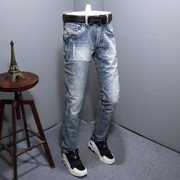 欧美风秋季浅蓝色水洗磨白刮烂破洞弹力修身小直脚牛仔裤男青年潮