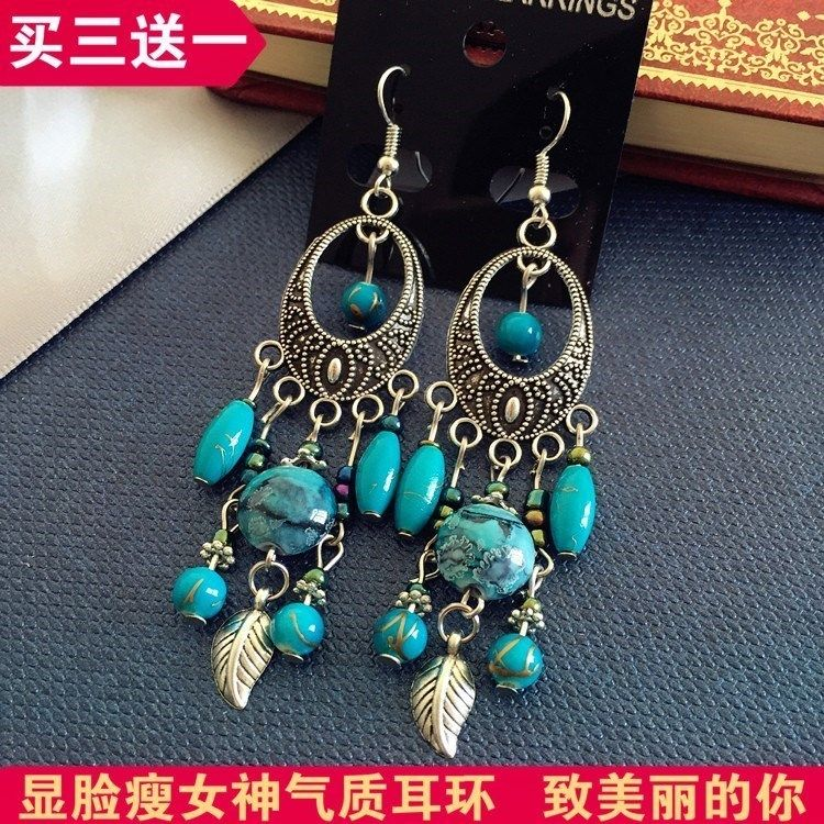 Yunnan ethnic style Lijiang characteristic womens earrings with retro design Miao silver personalized Tibetan Silver Earrings and Earrings