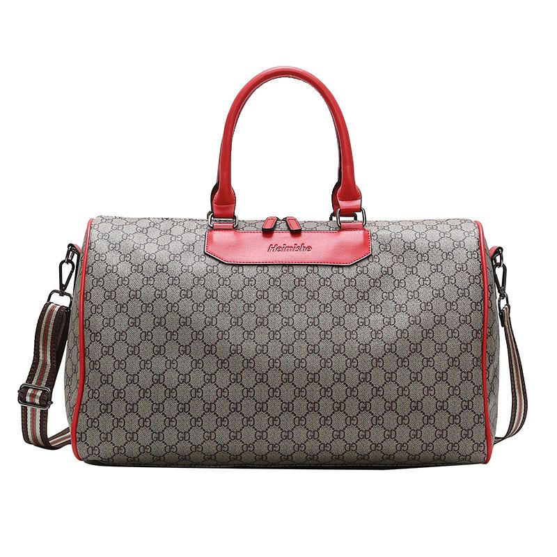 旅行包大容量女短途行李袋出差登机拉杆包手提打工行李大包男