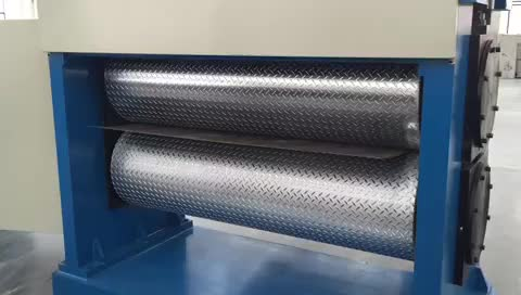 Embossing machine for stainless steel sheet