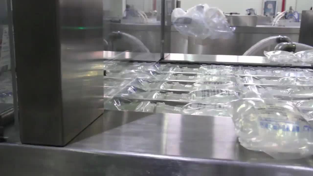 Sterilization packaging machine for medical drapes, surgical use