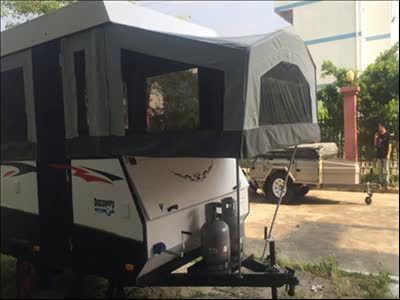 Full Equiped Touring Pop Up Campers Trailer in camperground
