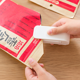 日本电热封口机迷你便携手压式塑料袋封口器家用小型零食袋密封器图片