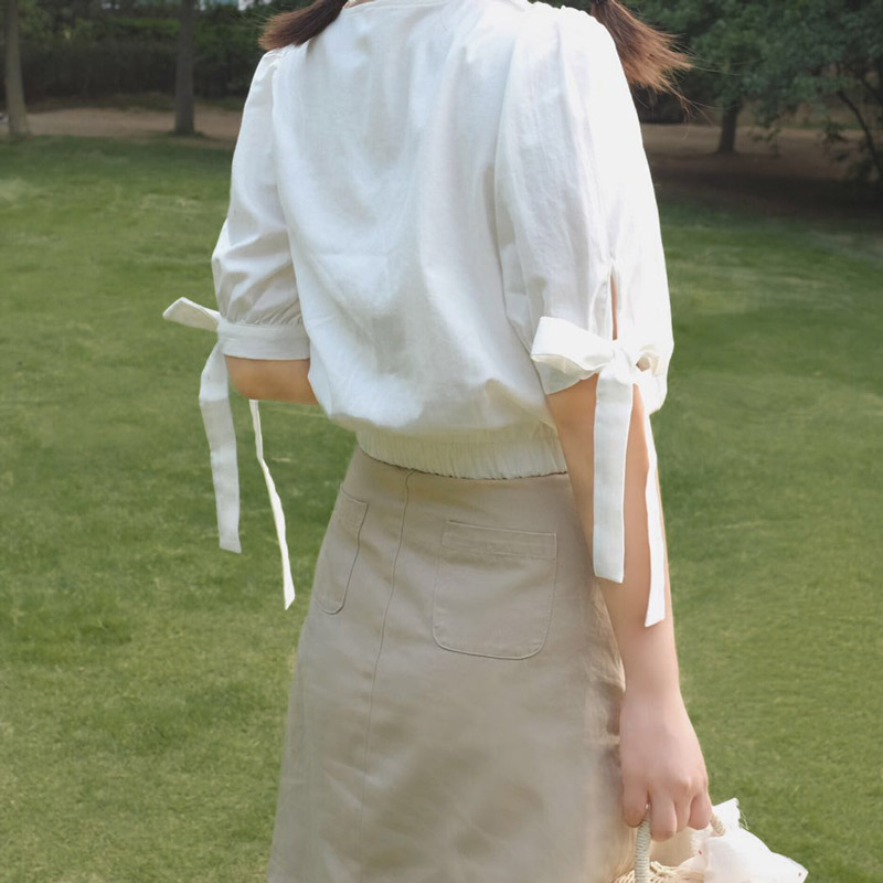 设计感女小众亚麻棉上衣女V领收腰遮肚袖口蝴蝶结系带衬衫2019夏