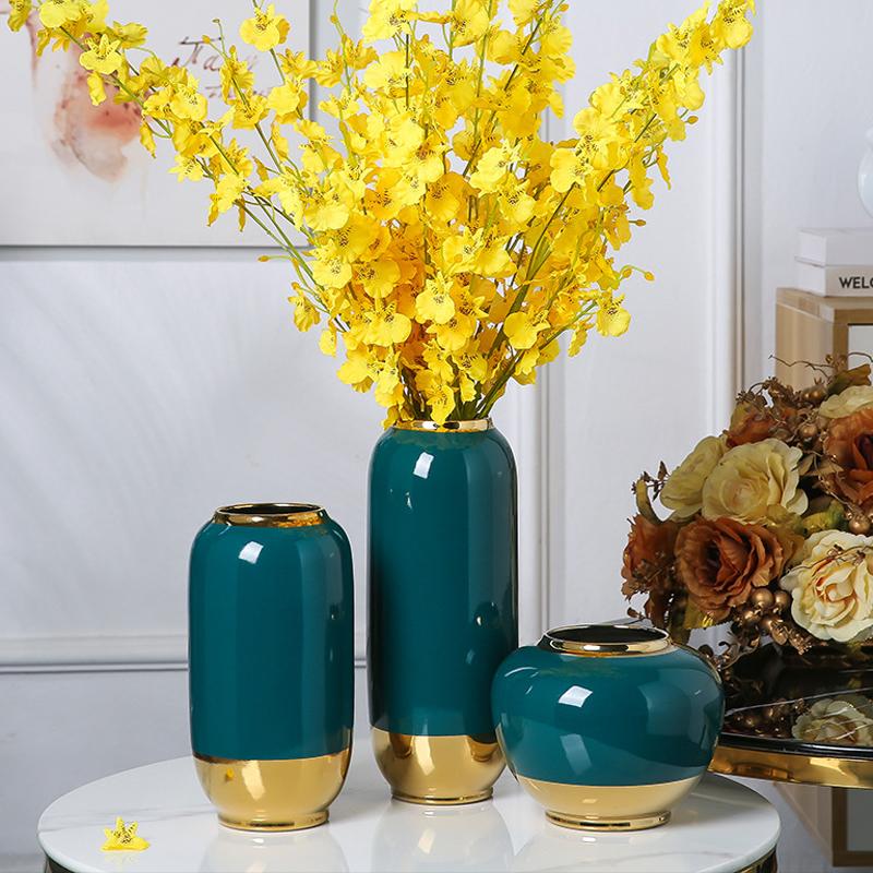 景徳鎮陶磁器の花瓶三点セット、墨緑のテーブルの玄関飾り、居間の生け花テレビキャビネット、新中国式