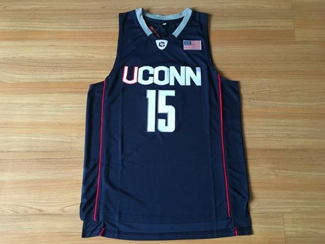 NCAAコネチカット大学15日に制定されました。バスケットボールの服は紺色の白い新生地のユニホームです。