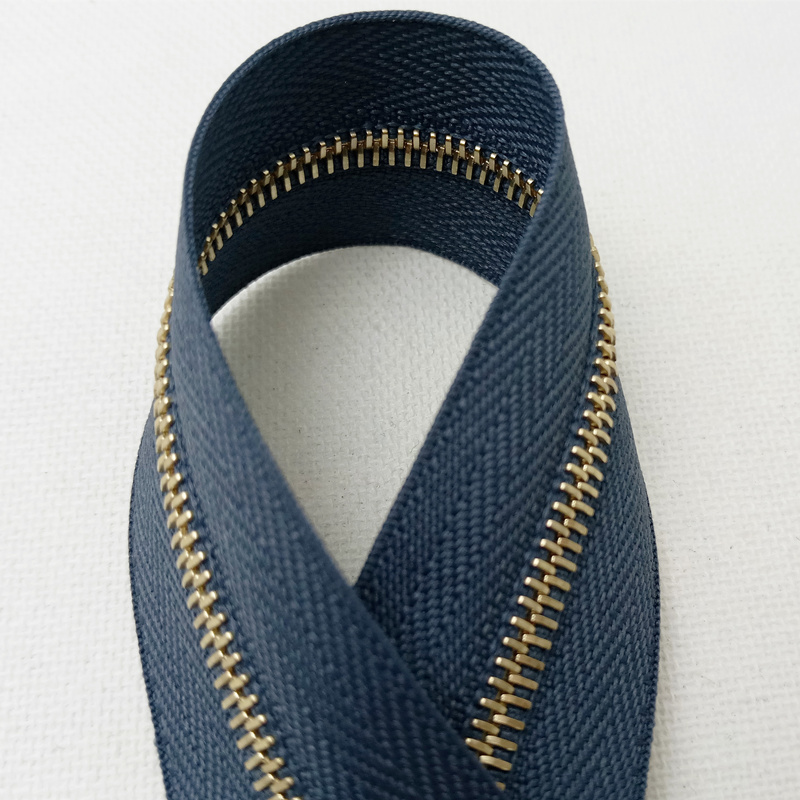 Genuine Swiss imported Riri code M4 gold tooth Lilly zipper 2123 blue gray tether cloth hard code with flat teeth