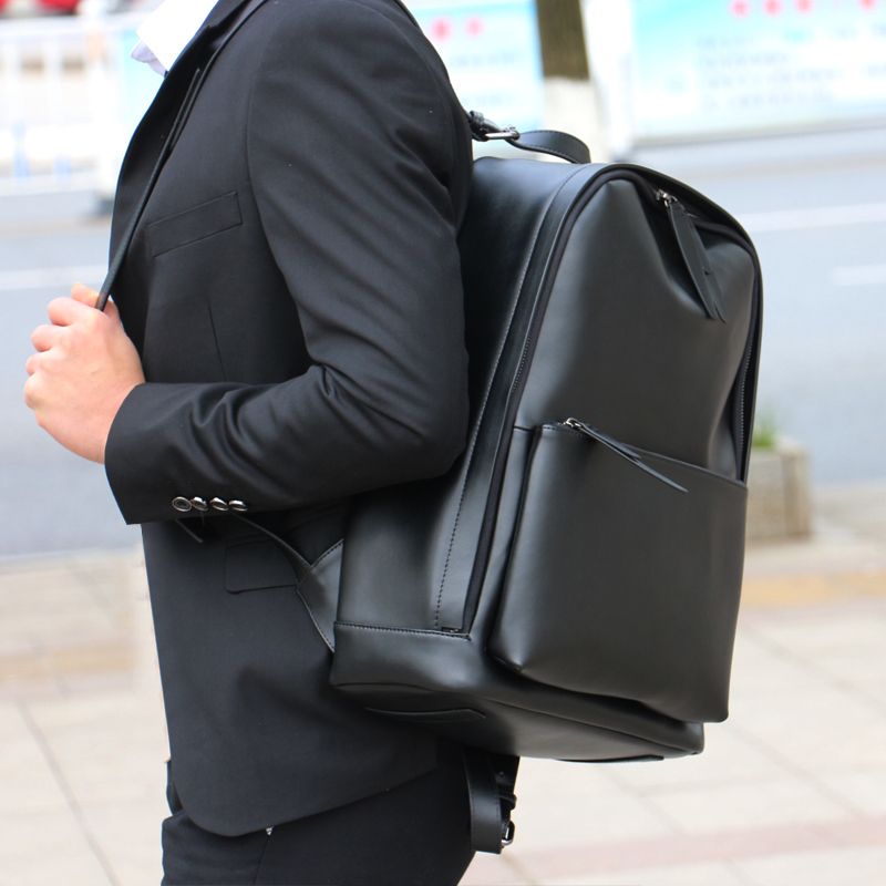 21 year new European and American youth versatile business leather backpack mens trend waterproof simple computer backpack