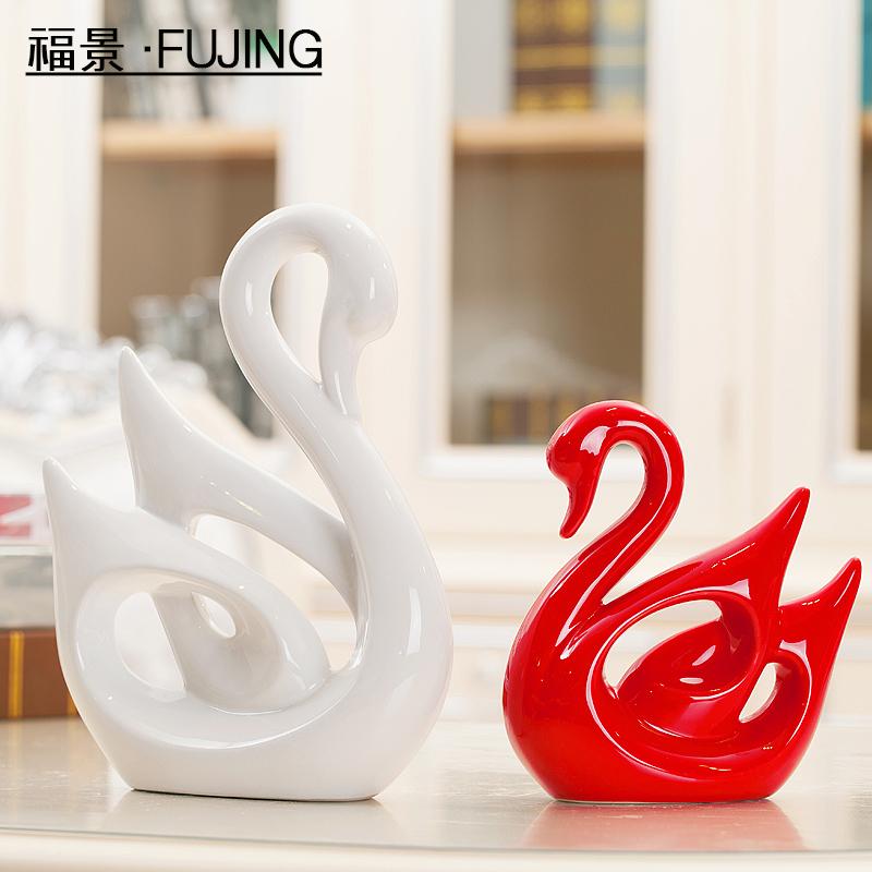 家居家装饰工艺品结婚礼物陶瓷创意客厅电视柜摆件设现代白红天鹅