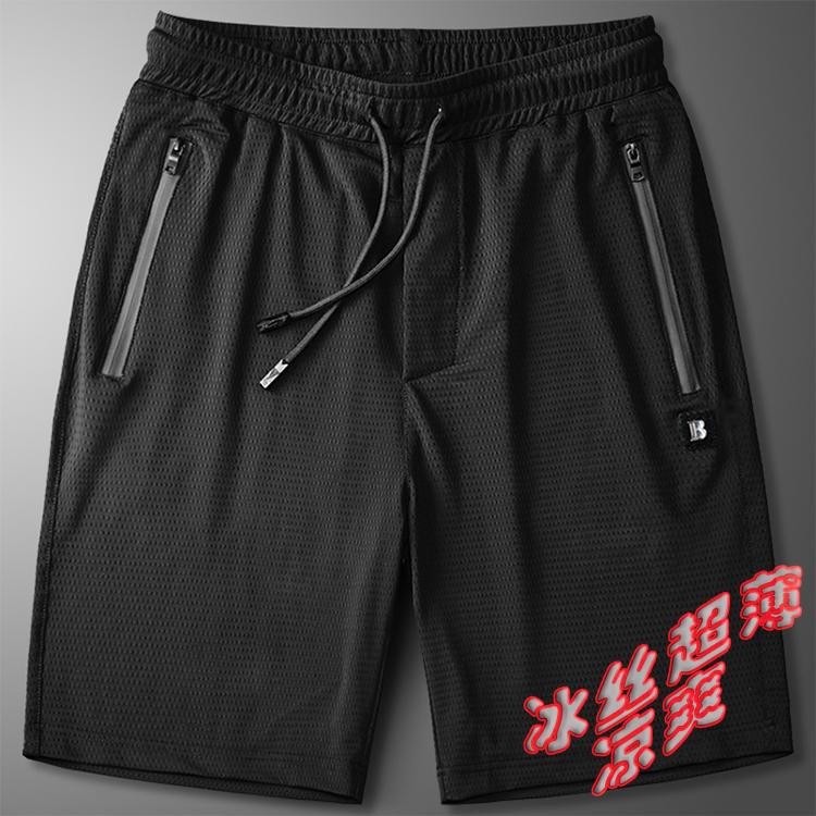 ズボンの男性の夏季の氷の糸の運動のショートパンツの男性のゆったりとしたランニングの極めて薄い空気を通す速乾の大きいサイズのカジュアルな5分のズボン