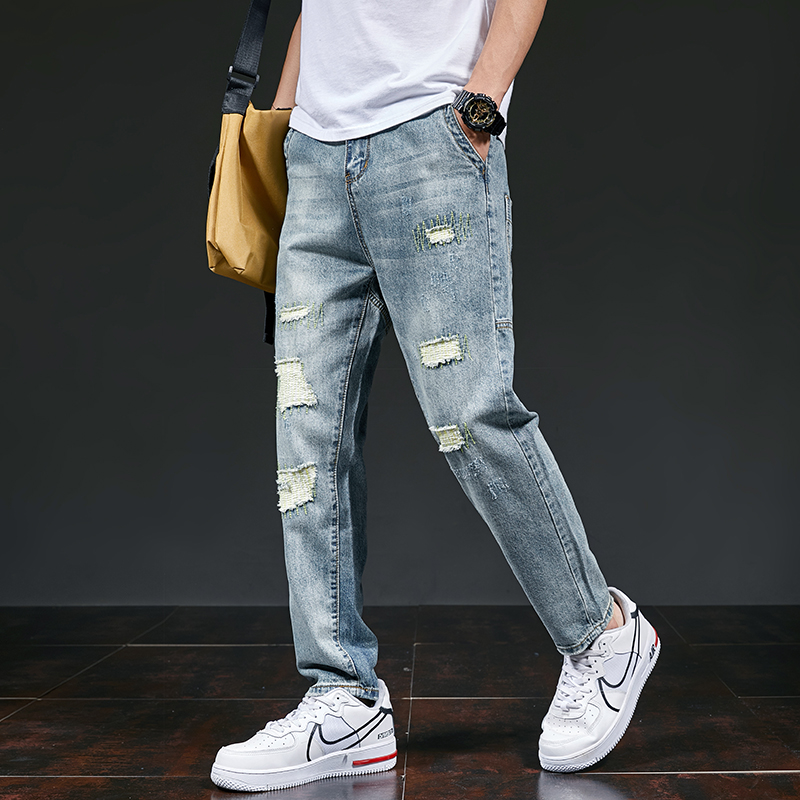 Autumn new mens pierced jeans fashion brand Korean casual pants youth student personality medium low waist and small leg pants