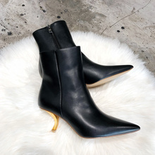 Plush pointed high heels, thin heels, short boots, women's middle heels, new European and American metal cat heels, women's boots fashion in autumn and winter 2019